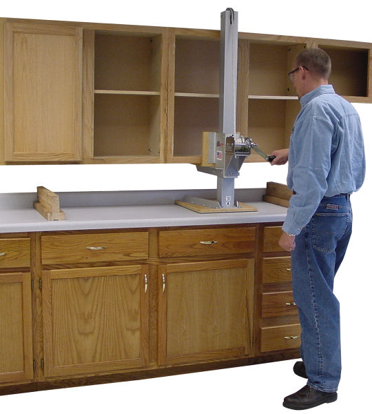 Install upper kitchen cabinets above lower cabinets